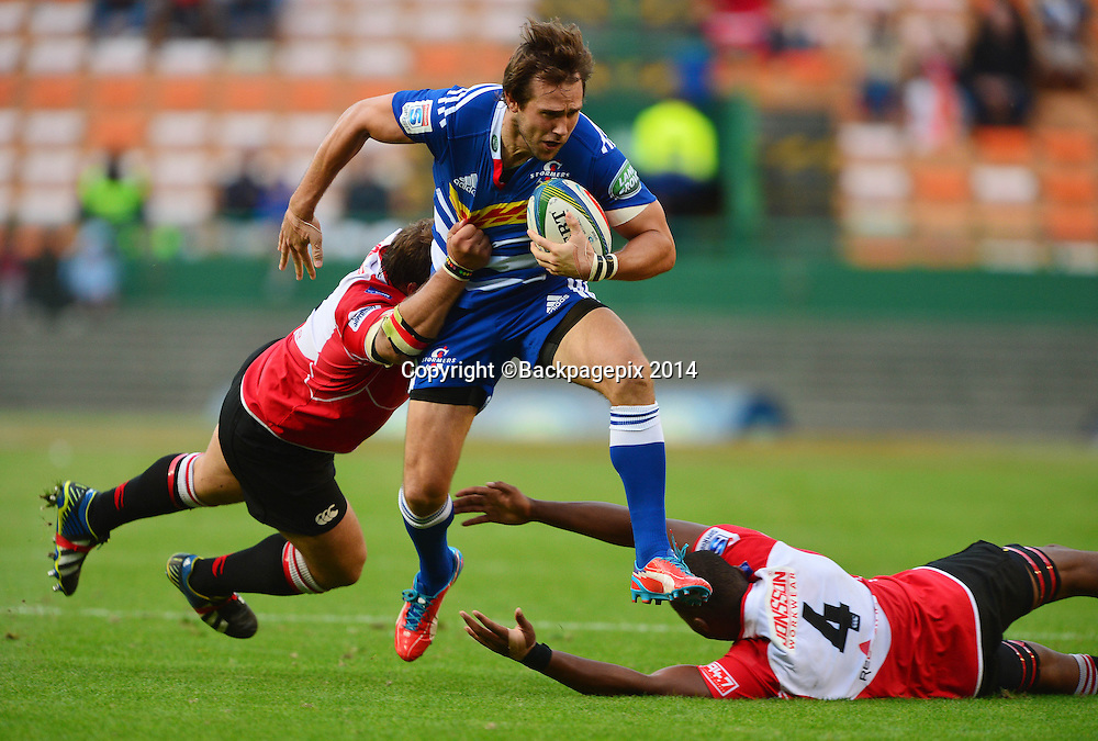 Peter Grant of The Stormers tackled by Julian Redelinghuys of The Lions and Martin Muller of The Lions during the 2014 Super Rugby Match between The Stormers and The Lions at Newlands Stadium, Cape Town on 19 April 2014 ©Chris Ricco/BackpagePix