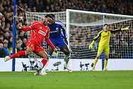 Raheem Sterling of Liverpool (left) holds off Kurt Zouma of Chelsea (2nd left) during the Capital One Cup Semi Final 2nd Leg match between Chelsea and Liverpool at Stamford Bridge, London, England on 27 January 2015. Photo by David Horn.