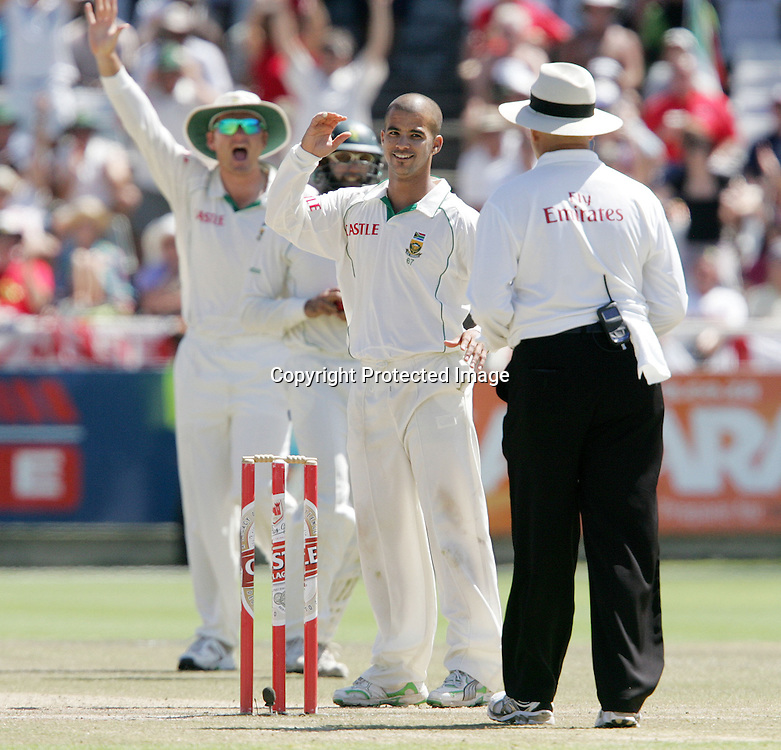 Jean Paul (JP) Duminy and Graeme Smith  appeal for the wicket of Paul Collingwood during the 5th day of the third test match between South Africa and England held at Newlands Cricket Ground in Cape Town on the 7h January 2010.Photo by: Ron Gaunt/ SPORTZPICS