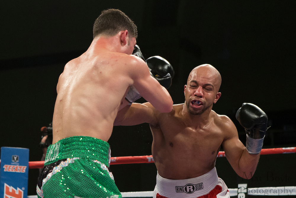 Ryan Picou (Red with White Trunks) from Las Vegas, NV, USA fights Julian Rodriguez (Black with Green Trunks) from Hasbrouck Heights, NJ, USA in a 4 round Super Lightweight bout at Boardwalk Hall in Atlantic City, NJ on Saturday December 7, 2013. (photo / Mat Boyle