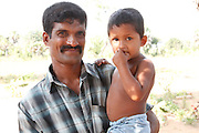 Ravikumar, 36 with his son Rajesh, aged 4. <br /> <br /> Ravikumar and his family lost everything in the conflict in Sri Lanka as they were displaced repeatedly over the course of two years.<br /> <br /> &quot;We had to keep moving because of the fighting. We're so glad to be home now, but we lost everything. When we got back to our home only one pillar of our house remained standing. Life has been very hard, but it is getting better now&quot;.<br /> <br /> To find out more about how DFID is helping in Sri Lanka, please visit www.dfid.gov.uk/srilanka ( http://www.dfid.gov.uk/srilanka ) <br /> <br /> Image: Russell Watkins / Department for International Development
