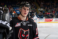 KELOWNA, CANADA - FEBRUARY 1: Andrei Grishakov #19 of the Calgary Hitmen celebrates a goal skating past teammates at the bench against the Kelowna Rockets on February 1, 2017 at Prospera Place in Kelowna, British Columbia, Canada.  (Photo by Marissa Baecker/Shoot the Breeze)  *** Local Caption ***