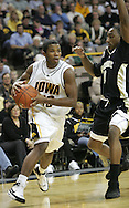26 NOVEMBER 2007: Iowa guard Jeff Peterson (30) tries to drive around Wake Forest guard Jeff Teague (0) in Wake Forest's 56-47 win over Iowa at Carver-Hawkeye Arena in Iowa City, Iowa on November 26, 2007.