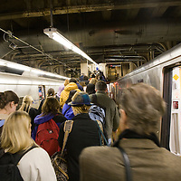 People leaving a commuter train, Grand Central Terminal, NYC, USA