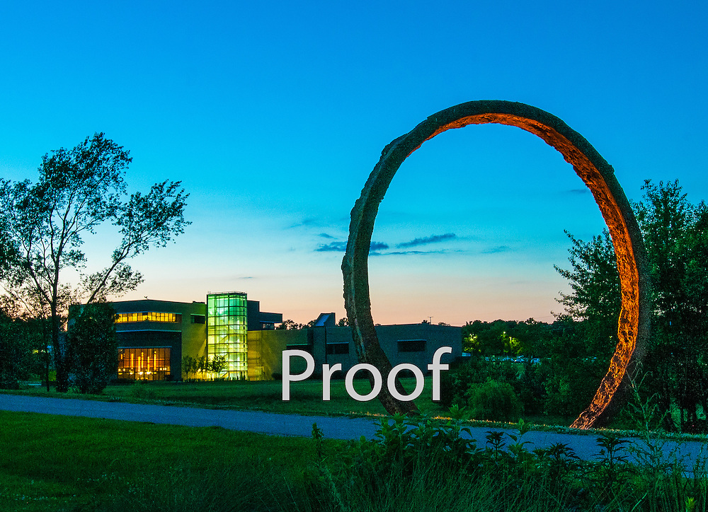 """North Carolina Museum of Art with one of sculptor Thomas Sayre's """"Gyre"""" rings in the foreground"""