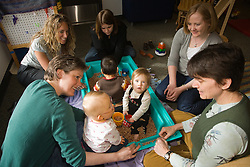 United States, Washington, Bellevue, group of mothers and infants in circle at Kindering Center
