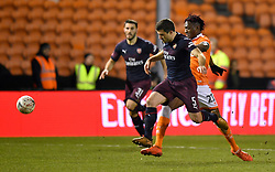 Arsenal's Sokratis Papastathopoulos (second right) and Blackpool's Armand Gnanduillet (right) battle for the ball during the Emirates FA Cup, third round match at Bloomfield Road, Blackpool.
