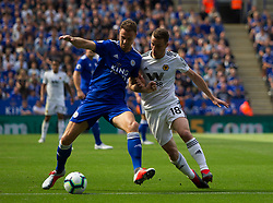 Jonny Evans of Leicester City (L) and Diogo Jota of Wolverhampton Wanderers in action - Mandatory by-line: Jack Phillips/JMP - 18/08/2018 - FOOTBALL - King Power Stadium - Leicester, England - Leicester City v Wolverhampton Wanderers - English Premier League