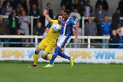 AFC Wimbledon midfielder Chris Whelpdale (11) and Rochdale FC midfielder Nathaniel Mendez-Laing (11) tussle during the EFL Sky Bet League 1 match between Rochdale and AFC Wimbledon at Spotland, Rochdale, England on 27 August 2016. Photo by Stuart Butcher.