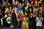"October 16, 2010 - A crowd applauds President Barack Obama after listening to him speak during a campaign rally for Governor Deval Patrick at the Hynes Convention Center in Boston on Saturday. During his address Obama compared the United States to a car that had been driven into a ditch, which Democrats were trying to push out. ""I thought Obama's story about pushing the car out of the ditch was great. We should keep it in drive,"" said Andre Mastey, a Democrat who attended the event. Photo by Lathan Goumas."