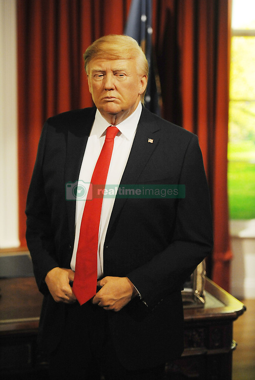 A wax figure of Donald Trump in the Oval office, is unveiled at Madame Tussauds in London, ahead of his inauguration as the 45th US president.