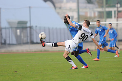 Matic Marusko #90 of Mura 05 vs. Ndiaye Welle #25 of Gorica during football match between ND Gorica and ND Mura 05 in 20th Round of PrvaLiga NZS 2012/13 on November 24, 2012 in Nova Gorica, Slovenia. (Photo By Ales Cipot / Sportida)