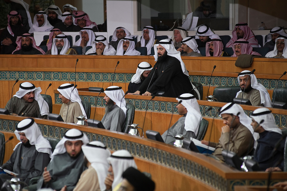 Member of Parliament Dr. Walid Al-Tabtabaie stands as he takes the oath of office following the state opening of the 14th legislative term's first session Feb. 15, 2012 in Kuwait City. Kuwaitis voted Feb. 2 for a new 50-member National Assembly (parliament).