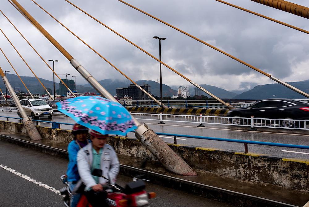 Traffic crosses a bridge spanning the Lancang (Mekong) in Xishuangbanna, Yunan, China.