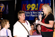 K99.1 FM's Nancy Wilson (right) and audience members play 'make a deal' on the runway stage during the Dayton Women's Fair at the Airport Expo Center in Vandalia., Saturday, September 17, 2011.