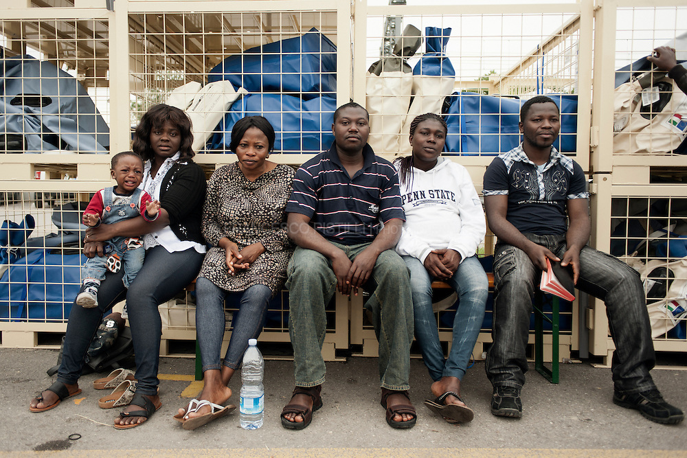 Italy. May 2012. Finale Emilia (MO). Displaced african workers in a Protezione Civile camp.<br /> <br /> At 4:05 a.m. local time on May 20th, a 6.0 Richter magnitude earthquake, struck the northern Italian region of Emilia-Romagna on 20 May 2012. The epicentre was between Finale Emilia and San Felice sul Panaro. Seven people dead including four workers at a Ceramics factory About 5.000 people have been left homeless. At least one hundred structures of historical significance have been damaged or destroyed.