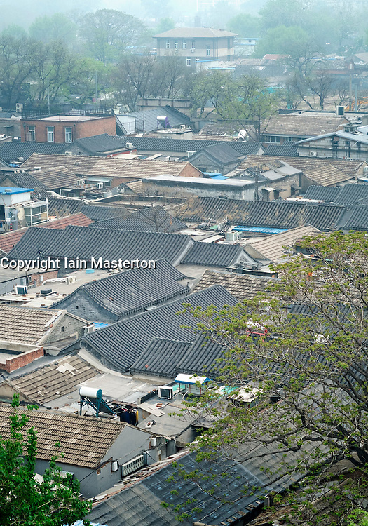 View of rooftops of old houses in area with many hutongs or lanes in central Beijing China