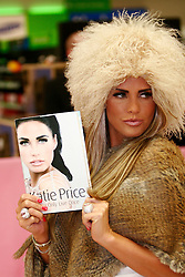 © under license to London News Pictures. 03/01/2011. Katie Price without her wedding ring at a signing of her book You Only Live Once at the Asda Walmart Superstore in Milton Keynes, Bucks today (03/01/2011). .Photo credit should read Craig Shepheard/London News Pictures