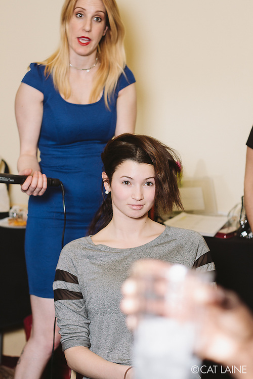 PROVIDENCE, RI - FEB 13: Betha Wood, StyleWeek NorthEast's Creative Director for Hair, demonstrates the look for the Stetkewicz show on Nicole Pallozzi for the Stetkewicz show as part of StyleWeek NorthEast on February 13, 2015 in Providence, Rhode Island. (Photo by Cat Laine)