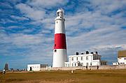 Red and white lighthouse on the coast at Portland Bill, Isle of Portland, Dorset, England, UK