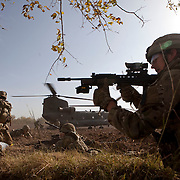 Soldiers of 3 SCOTS (The Black Watch) and 1 PWRR return fire whilst fellow soldiers run across an open field under fire from an insurgent sharpshooter as they CASEVAC a fellow soldier. Private Stephen Bainbridge, aged 25, from Kirkcaldy who was gravely wounded after an IED explosion traumatically amputated his right leg and damaged his left so badly that it too later had to be amputated. His life was saved by the swift actions of Cpl John Goodie (21) a medic with 1 PWRR (The Princess of Wales's Royal Regiment) who applied tourniquets and first field dressings to get the bleeding under control. Private Chis Watson (21) also assisted in the treatment whilst reassuring the casualty and keeping him alert and responsive. Once safely on board the helicopter he was rushed to surgery at Bastion Field Hospital.  Loya Manda, Nad e Ali, Helmand Province, Afghanistan on the 11th of November 2011.