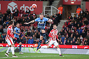 Tottenham Hotspur defender Toby Alderweireld (4) clears the cross during the Barclays Premier League match between Stoke City and Tottenham Hotspur at the Britannia Stadium, Stoke-on-Trent, England on 18 April 2016. Photo by Simon Davies.
