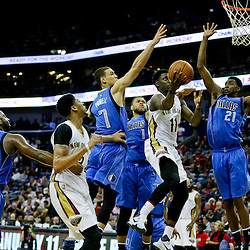Jan 6, 2016; New Orleans, LA, USA; New Orleans Pelicans guard Jrue Holiday (11) is defended by Dallas Mavericks forward Dwight Powell (7) and forward Jeremy Evans (21) during the second half of a game at the Smoothie King Center. The Mavericks defeated the Pelicans 100-91. Mandatory Credit: Derick E. Hingle-USA TODAY Sports