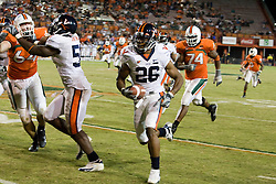 Virginia cornerback Chris Cook (26) returns a fumble recovery for a touchdown.  The #19 Virginia Cavaliers defeated the Miami Hurricanes 48-0 at the Orange Bowl in Miami, Florida on November 10, 2007.  The game was the final game played in the Orange Bowl.