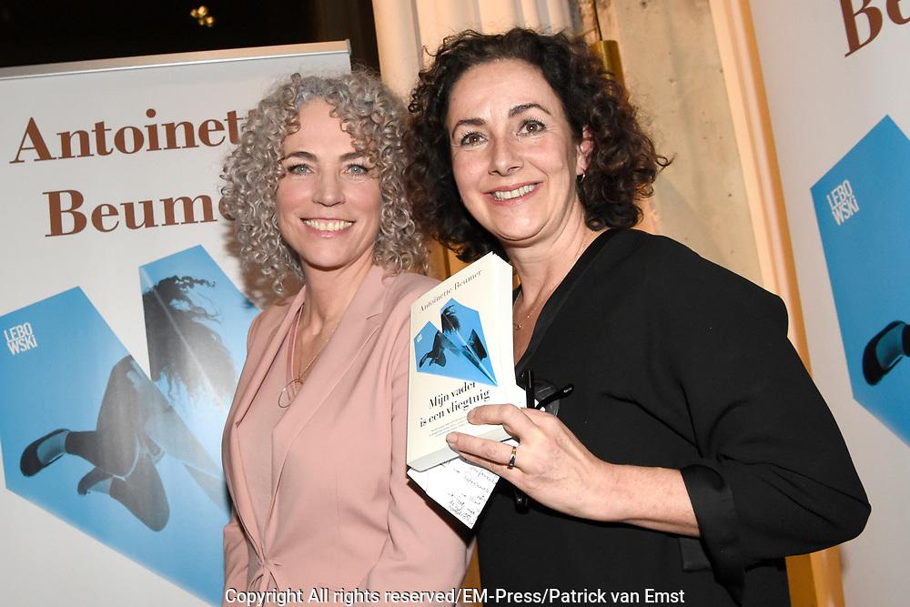 Boekpresentatie Mijn vader is een vliegtuig &ndash; Antoinette Beumer in de Loft van de Adam Toren, Amsterdam.<br /> <br /> Op de foto:  Antoinette Beumer geeft het eerste exemplaar aan Femke Halsema