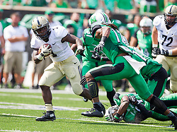 Sep 6, 2015; Huntington, WV, USA; Purdue Boilermakers running back D.J. Knox breaks a tackle during the first quarter against the Marshall Thundering Herd at Joan C. Edwards Stadium.  Mandatory Credit: Ben Queen-USA TODAY Sports