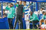 Queens Park Rangers Caretaker Manager John Eustace talking to substitute Queens Park Rangers forward Lewis Walker (34) during the EFL Sky Bet Championship match between Queens Park Rangers and Swansea City at the Loftus Road Stadium, London, England on 13 April 2019.