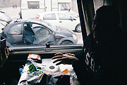 Man eating inside a car at Napoli NYE Tek, a New Year's Eve party in Naples, Italy, December 2014