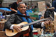 A guitar player tuning up before a performance at the Occupy Wall Street movement in Zuccotti Park. October 21, 2011.