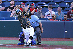 03 June 2016: Dillon Haupt bats, Corey Bass catches and Dave Fields umpires during a Frontier League Baseball game between the Windy City Thunderbolts and the Normal CornBelters at Corn Crib Stadium on the campus of Heartland Community College in Normal Illinois