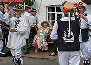Thaxted Morris Weekend 3-4 June 2017<br /> A meeting of member clubs of the Morris Ring celebrating the 90th anniversary of the founding of the Thaxted Morris Dancing side or team in Thaxted, North West Essex, England UK. <br /> Outside The Crown pub at Little Walden in Essex members of various sides dance.<br /> Hundred of Morris dancers from the UK and this year the Silkeborg side from Denmark spend most of Saturday dance outside pubs in nearby villages where much beer is consumed. In the late afternoon all the sides congregate in Thaxted where massed dancing is perfomed along Town Street. As darkness falls across Thaxted the spell binding Abbots Bromley Horn Dance is performed to the sound of a solo violin in the dark.