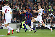 LIONEL MESSI of FC Barcelona duels for the ball with EDIN DZEKO of AS Roma during the UEFA Champions League, quarter final, 1st leg football match between FC Barcelona and AS Roma on April 4, 2018 at Camp Nou stadium in Barcelona, Spain - Photo Manuel Blondeau / AOP Press / ProSportsImages / DPPI