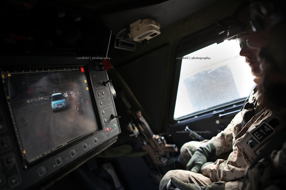 Top gunner oberves the surrounding during a patrol and focuses on a approaching car. In late October 2011 Kunduz based 3.Task Force started a several days operation in and around Nawabad (District Chahar Darah), west of Kunduz, northern Afghanistan. During the Operation Orpheus about 100 german infantery soldiers rolled out for patrols through the town and surrounding areas, which were expected as a retreat zone of insurgents.
