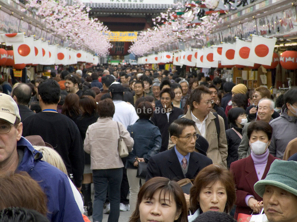 worshippers and tourist at the Asakusa Kannon Temple Tokyo spring time Cherry Blossom