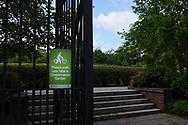 """please walk your bike in Conservatory Garden"" sign in Central Park."