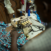 A tailor working on a pagne, the tipical Congolese tissue. Lydie Malingumu likes to mix the Congolese traditions with some new occidental elements as strass and silk. CAPTA/FEDERICO SCOPPA