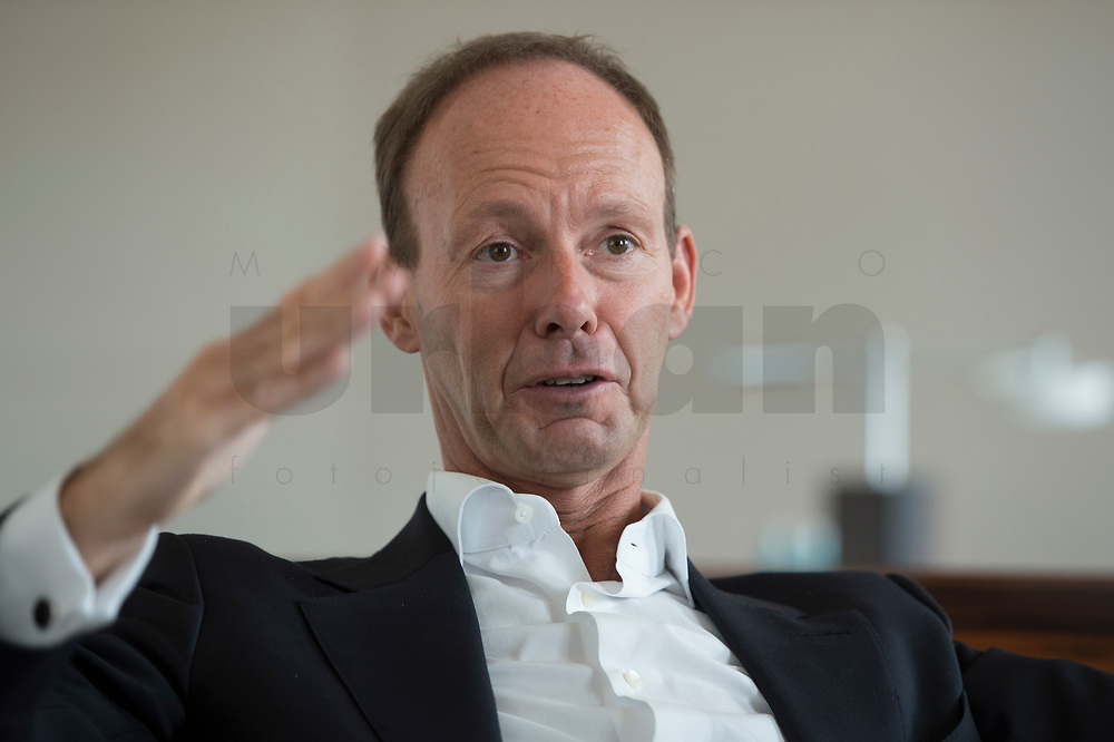 26 MAR 2014, BERLIN/GERMANY:<br /> Thomas Rabe, Vorstandsvorsitzender der Bertelsmann SE & Co. KGaA, waehrend einem Interview, Bertelsmann Repräsentanz<br /> Thomas Rabe, chairman of the board Bertelsmann SE & Co. KGaA, during an interview, Bertelsmann Repräsentanz<br /> IMAGE: 20140326-01-011