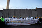 Frankfurt am Main | 01 Apr 2015<br /> <br /> On Wednesday, April 1, 2015, about 60 left-wing activists gather at the Frankfurt Preungesheim detention center to express solidarity with Federico Annibale (called Fede), a young italian activist who was arrested during the Blockupy protests in Frankfurt on March 18, 2015. Mr. Annibale is held in investigative custody for accusations wich are still undisclosed and unclear.<br /> Here: Activists are holding a banner at the outer wall of the detention center.<br /> <br /> &copy;peter-juelich.com<br /> <br /> [No Model Release | No Property Release]