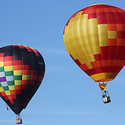 Hot Air balloons in the skies around rural Michigan near Battle Creek as they reach a target area during competition in the 20th FAI World Hot Air Ballooning Championships. Battle Creek, Michigan, USA. 22nd August 2012. Photo Tim Clayton