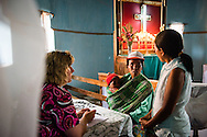 Connie Catron (left) with the Mercy Medical Team treats patients Saturday, Oct. 18, 2014, at a Fiangonana Loterana Malagasy (FLM) Lutheran church in Antsoantany, Madagascar. LCMS Communications/Erik M. Lunsford