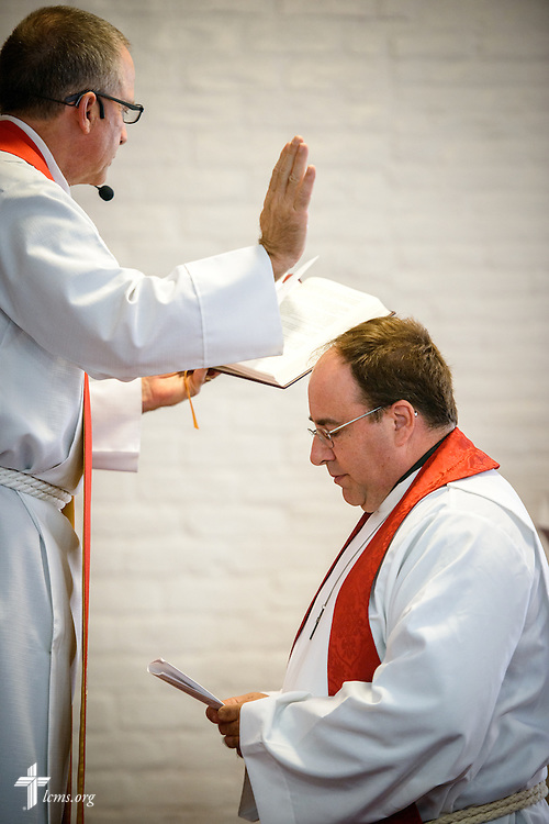 The Rev. Mark Barz, third vice president of the Texas District and pastor of Crown of Life Lutheran Church, San Antonio, Texas, installs the Rev. Dr. Antonio Lopez, new national missionary pastor at El Calvario Lutheran Church on Sunday, July 31, 2016, at the parish in Brownsville, Texas. LCMS Communications/Erik M. Lunsford