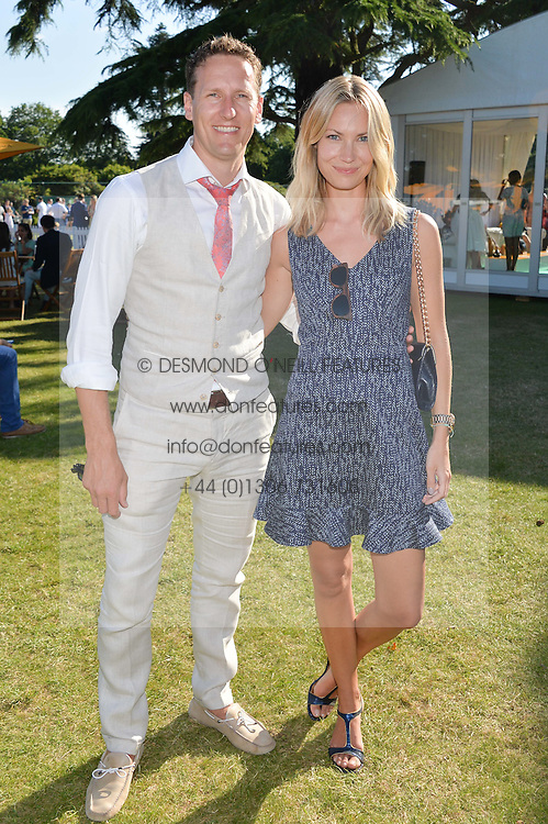 BRENDAN & ZOE COLE at the Summer Solstice Party during the Boodles Tennis event hosted by Beulah London and Taylor Morris at Stoke Park, Park Road, Stoke Poges, Buckinghamshire on 21st June 2014.