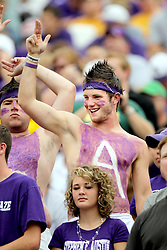 A Stephen F. Austin fan gives the Lumberjack gesture during an NCAA college football game, Saturday, Sept. 17, 2011, in Waco, Texas. Baylor won 48-0.