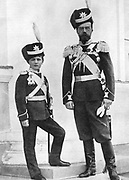 Nicholas II (1868-1918) Emperor of Russia from 1894 with his son Alexis (1904-1918), the Tsarevich, in military uniform. Alexis was a haemophiliac. After a photograph.