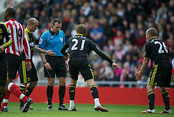 SUNDERLAND, ENGLAND - Sunday, March 20, 2011: Liverpool's Lucas Leiva and Raul Meireles pursued referee Kevin Friend that Jay Spearing was foulded in the penalty area to award the Reds a penalty against Sunderland during the Premiership match at the Stadium of Light. (Photo by David Rawcliffe/Propaganda)