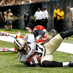 Aug 9, 2013; New Orleans, LA, USA; New Orleans Saints wide receiver Preston Parker (87) catches a touchdown past Kansas City Chiefs cornerback Vince Agnew (34) during the second half of a preseason game at the Mercedes-Benz Superdome. The Saints defeated the Chiefs 17-13. Mandatory Credit: Derick E. Hingle-USA TODAY Sports